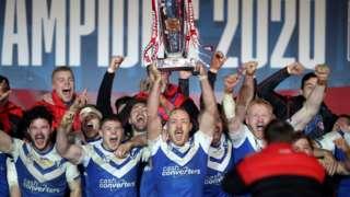 St Helens lift the Super League trophy