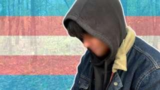 Trans man wearing hood