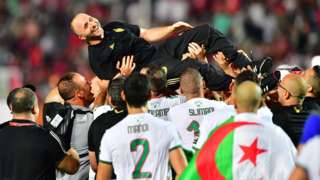 Algeria coach Djamel Belmadi is lifted in the air by his players after winning the 2019 Africa Cup of Nations title