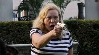 Patricia McCloskey aiming a handgun at protesters outside her home