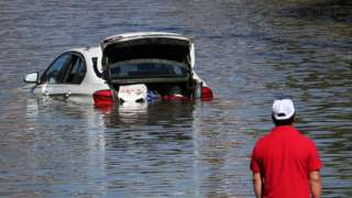 A car submerged in flood waters from Hurricane Ida