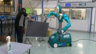 The Secondhand robot works with a maintenance technician