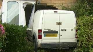 Van crashed in house