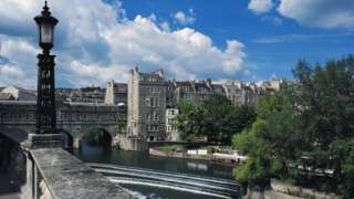 The town of Bath, seen from Pulteney Bridge on the River Avon