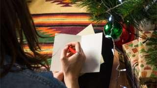 Girl writing Christmas card