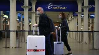 Passengers wearing facemasks at the Eurostar terminal at St Pancras station in London