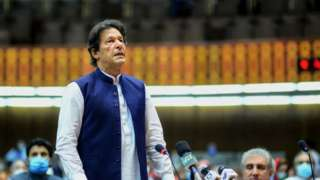 """Pakistan""""s Prime Minister Imran Khan (L) speaks during the National Assembly session in Islamabad."""