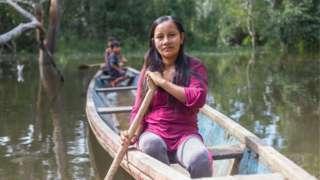 Liz Chicaje Churay in a canoe