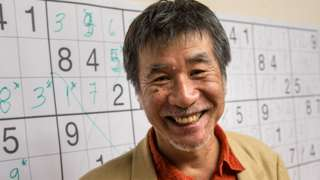Japanese puzzle manufacturer Maki Kaji poses for a picture during the Sudoku first national competition in Sao Paulo, Brazil, on 29 September 2012