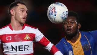 Jon Taylor of Doncaster Rovers (left) and Aaron Pierre of Shrewsbury Town