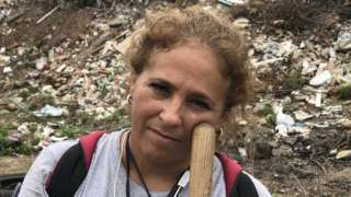 Maria Isabel Cruz takes a break from digging for human remains