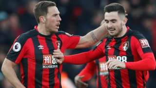 Bournemouth's Dan Gosling celebrates with Lewis Cook