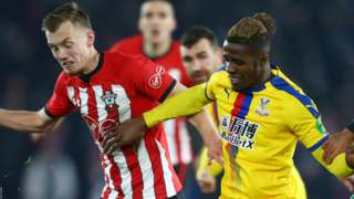 Wilfried Zaha tangles with James Ward-Prowse during Southampton's clash with Crystal Palace in the Premier League