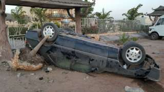 A car that overturned after speeding in The Gambia