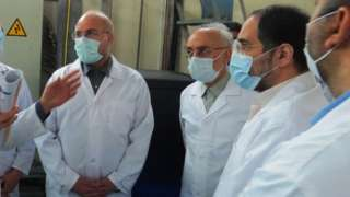 A handout photo made available by the Atomic Energy Organisation of Iran shows Iranian Parliamentary speaker Mohammad Baqer Qalibaf (L) and head of Atomic Energy Organisation of Iran Ali Akbar Salehi (2nd L) visiting the Fordo enrichment facility in Iran (28 January 2021)