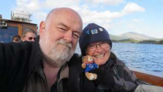 Sue Cooper and her partner Simon on a boat