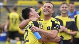 Harrogate players celebrate victory against Boreham Wood