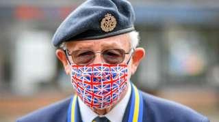 Ex RAF serviceman Tom Blundell wears a Union flag mask