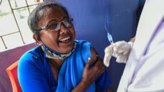 A woman is vaccinated against COVID-19 (Bharat Biotech COVAXIN) at a government hospital on March 6, 2021 in Barpeta, India.