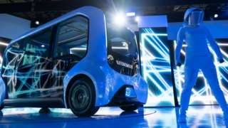 A dancer performs next to Toyota's e-Palette Concept autonomous vehicle during a press conference at the Tokyo Motor Show 2019.