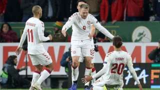 Denmark players celebrate Jorgensen's goal