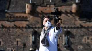 a visitor outside Edinburgh Castle