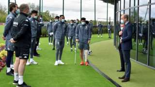 Prince William, Duke of Cambridge speaks to Aston Villa players during a visit to the club's high performance centre at Bodymoor Heath