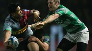 Ben Tapuai of Harlequins is tackled by John Hardie and Alex Tait of Newcastle Falcons