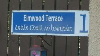 An unofficial sign in Lurgan shows a street name in English and Irish