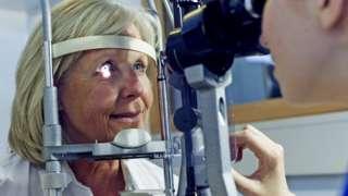 older woman having eye test