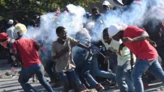 A tear gas canisters hits protesters in Port-au-Prince, Haiti. Photo: 13 February 2019