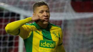 Dwight Gayle celebrates scoring for West Brom against Stoke