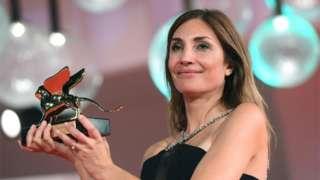 Director Audrey Diwan holds the Golden Lion