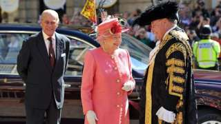 Queen Elizabeth II, accompanied by the Prince Phillip, Duke of Edinburgh, are greeted by the Lord Mayor of Birmingham Councillor John Lines as they arrive for her Diamond Jubilee visit to the City on July 12, 2012 in Birmingham,
