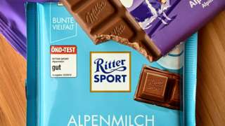 A divided bar of Milka chocolate in half lies on a Ritter Sport bar, in Duesseldorf, Germany, 17 July 2020
