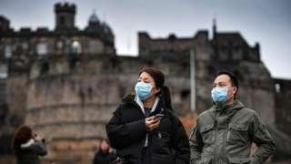 Tourists in masks at Edinburgh Castle