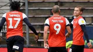 Luke Berry (right) celebrates his goal for Luton