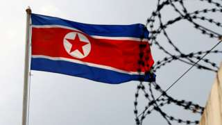A North Korea flag flutters next to concertina wire at the North Korean embassy in Kuala Lumpur, Malaysia March 9, 2017.