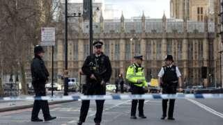 Policemen outside Westminster