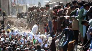 Afghans struggle to reach the foreign forces to show their credentials to flee the country outside the Hamid Karzai International Airport, in Kabul, Afghanistan, 26 August 2021