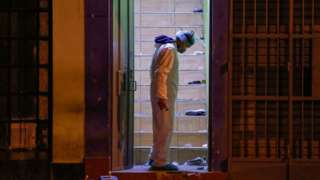 Police investigator stands on the site where 13 people were killed in a crush at a nightclub doorway on 22 August 2020