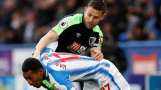 Bournemouth captain Simon Francis in action against Huddersfield