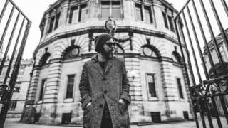 Gaz Coombes in front of the Sheldonian Theatre