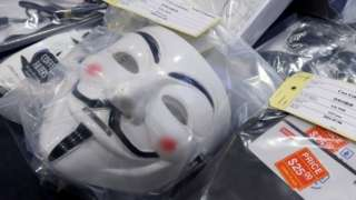 A Guy Fawkes mask is seen at a media conference given by Hong Kong police