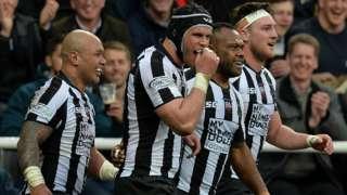 Newcastle Falcons players celebrate Niki Goneva's try at St James' Park