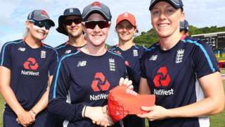 Kirstie Gordon is presented with her debut England cap by Heather Knight