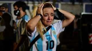 A fan of Argentinian football legend Diego Maradona cries