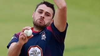 Nathan Buck bowls for Northants