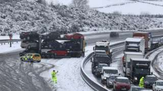 Jack-knifed car transporter on M80 near Falkirk