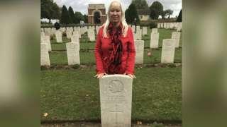 Gwyneth Jones behind grave